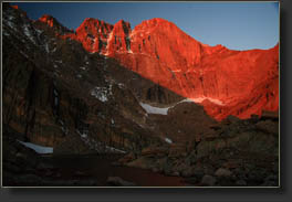 First minute of red morning sunshine on the Longs Peak