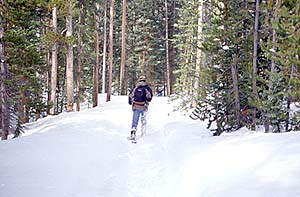 Mark slogging through the snow on the trail to Ranger Lakes, Dec 1997